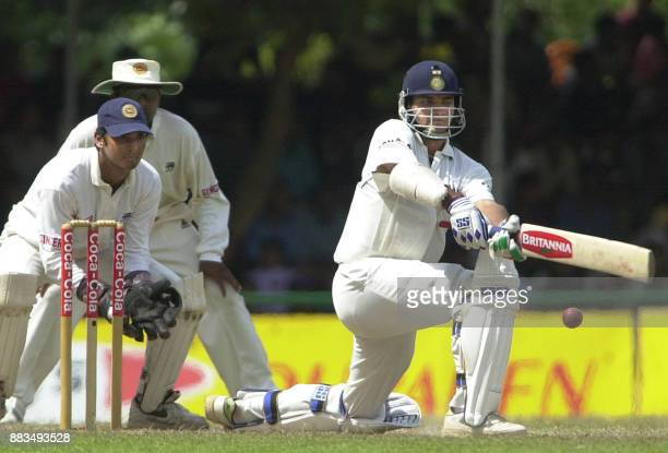Indian skipper and ManoftheMatch Sourav Ganguly sweeps a delivery on way to making an unbeaten 98 runs as Sri Lankan wicketkeeper Kumara Sangakkara...