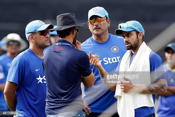 Indian skipper MS Dhoni his deputy Virat Kohli and Team Director Ravi Shastri during the training session on the eve of the 3rd T20 against South...