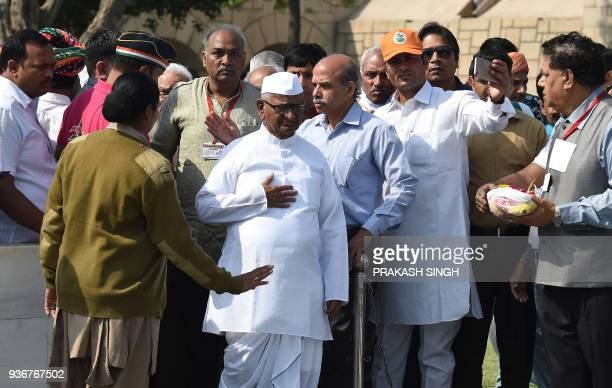 Indian social activist Anna Hazare arrives at Rajghat to pay tribute ahead of the start of an indefinite protest against the central government in...