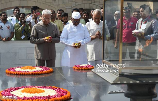 Indian social activist Anna Hazare pays tribute at Rajghat ahead of the start of an indefinite protest against the central government in New Delhi on...
