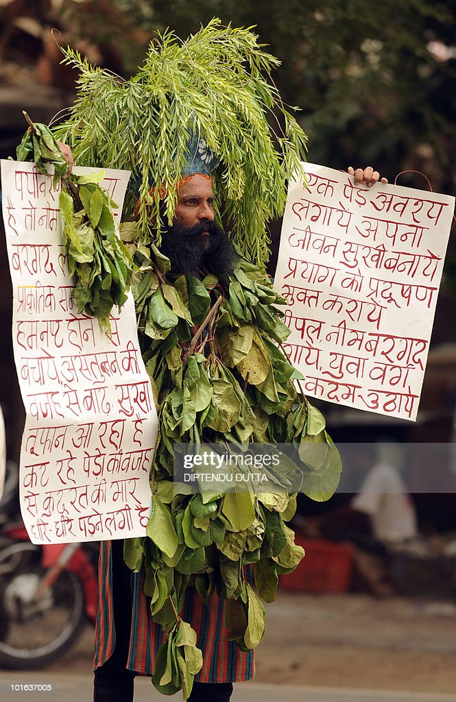 Indian social activist Rajendra Kumar Tiwari wears tree leaves as he takes part in an awareness campaign in Allahabad on the occasion of 'World Environment Day' June 5, 2010. This year the theme of World Environment Day 2010 is 'Many Species. One Planet. One Future'. The theme reflects the important task of saving and conserving the different forms of life on earth. AFP PHOTO/Diptendu DUTTA