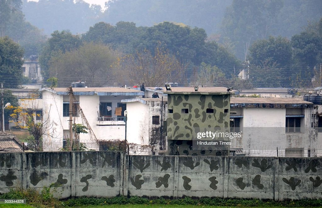 Indian soldiers are seen conducting search operations on a rooftops of quarters at Pathankot Air Force Base during a terror strike on January 4 2015..