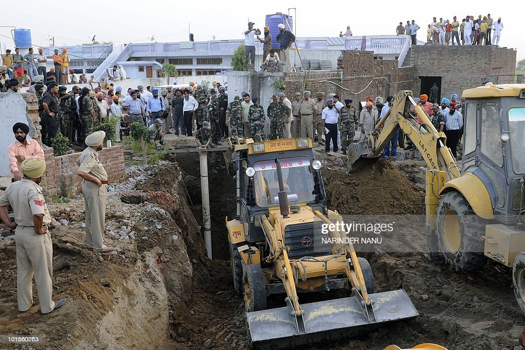 Indian soldiers attempt to rescue three-year old girl Dilnaj Kaur after she fell into a borewell at Dhira village, about 20 kms from Batala in Gurdaspur district, on June 2, 2010. Kaur accidentally fell into the borewell while playing in the courtyard of her uncle's house, police said.