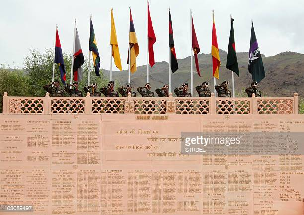 Indian soldiers blow bugles from the Kargil War Memorial in honour of the eleventh anniversary of the Kargil war in the Drass sector of Ladakh on...