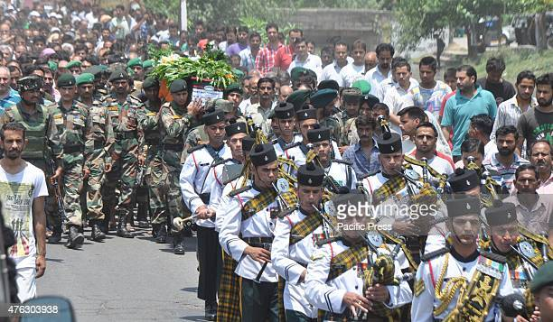 Indian soldiers carry the coffin of Havildar Satpal Bhasin one of the 18 soldiers of 6 Dogra Regiment who were killed in a terrorist attack in Indias...