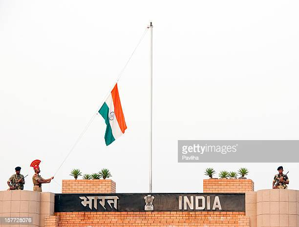 indian soldiers lowering flag wagah - national border stock pictures, royalty-free photos & images