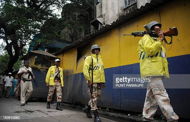 Indian soldiers patrol outside the Arthur Road Prison where the lone surviving gunman Mohammaed Kasab from the 2008 Mumbai attacks is held in Mumbai...