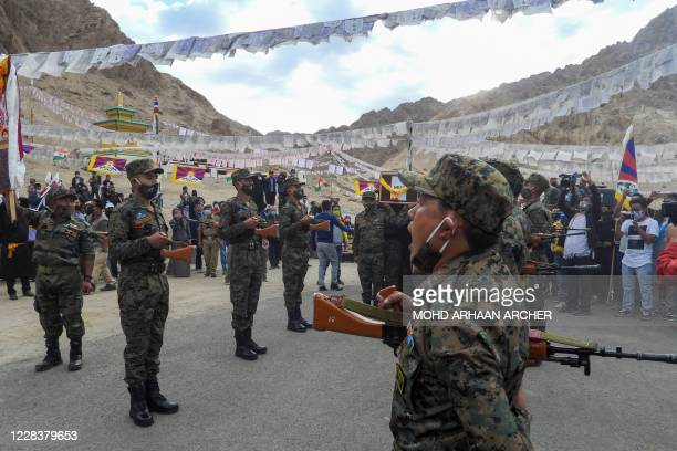 Indian soldiers pay their respects during the funeral of their comrade, Tibetan-origin India's special forces soldier Nyima Tenzin in Leh on...