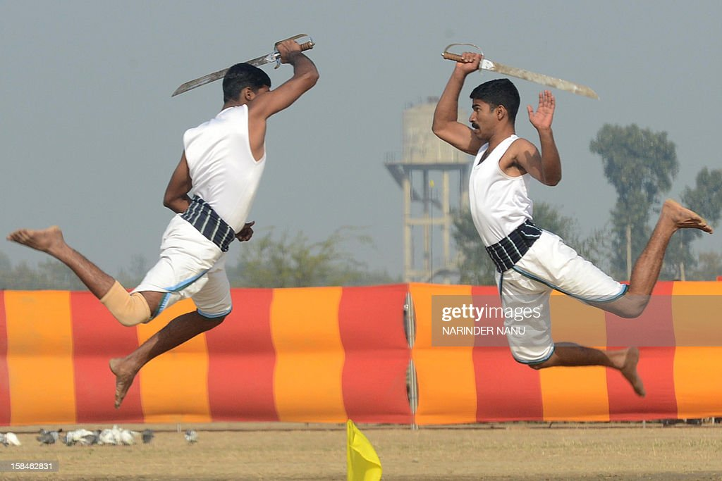Indian soldiers perform the Indian martial art Kalaripayattu during an Army Mela (fair) and exhibition at Khasa, some 15 kms from Amritsar, on December 17, 2012. The Army Mela (fair ), organised by the Vajra Corps, displayed weapons, tanks, aircraft and military equipment to students and civilian visitors of the event.