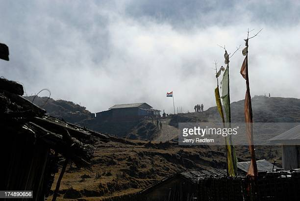 Indian soldiers play skittles on a table set up on a hill overlooking Kalapokhri village along the Sandakphu Trail one of the most popular trekking...