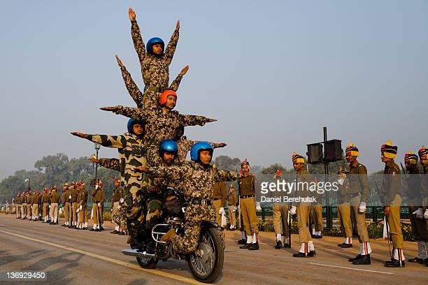 Indian soldiers practice their stunts on Royal Enfield motorcycles in preparation for the upcoming Republic Day parade on January 11 2012 in New...