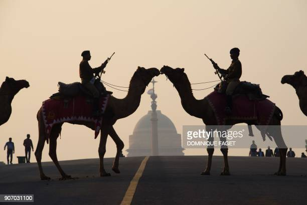TOPSHOT Indian soldiers ride camels during a rehearsal for the 'Beating the Retreat' ceremony in New Delhi on January 19 2018 ahead of India's...