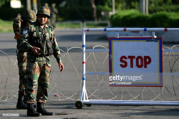 Indian soldiers stand guard at a checkpoint at Panchkula on August 26 after followers of controversial guru Ram Rahim Singh on August 25 went on a...