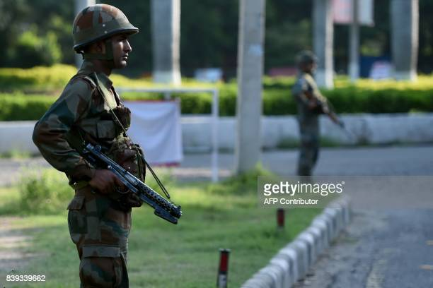 Indian soldiers stand guard at Panchkula on August 26 after followers of controversial guru Ram Rahim Singh on August 25 went on a rampage after...