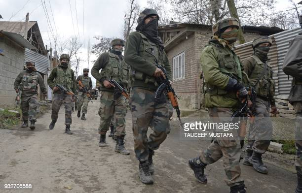 Indian soldiers take part in a search operation after a gunbattle between suspected militants and government forces in the Balhama area of Khanmoh...