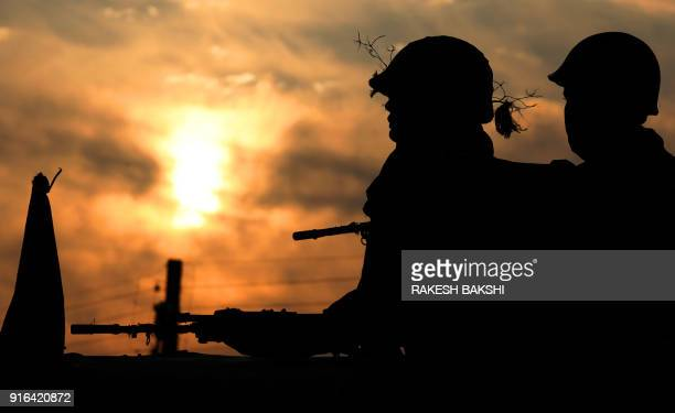 TOPSHOT Indian soldiers take positions outside the Sunjuwan Military Station in Jammu on February 10 following an attack by militants Two people were...