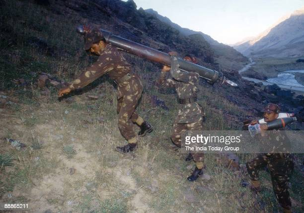 Indian Soldiers taking artillery equipment up the mountains during Kargil War