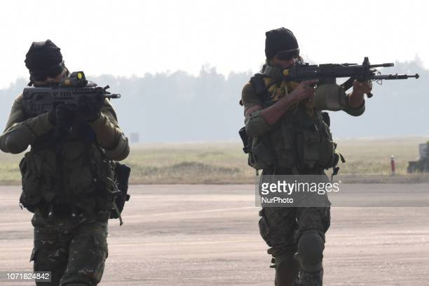 Indian special force commandos take position after landing on a runway from a moving C130 transport aircraft during Indian Air Force and US Air Force...