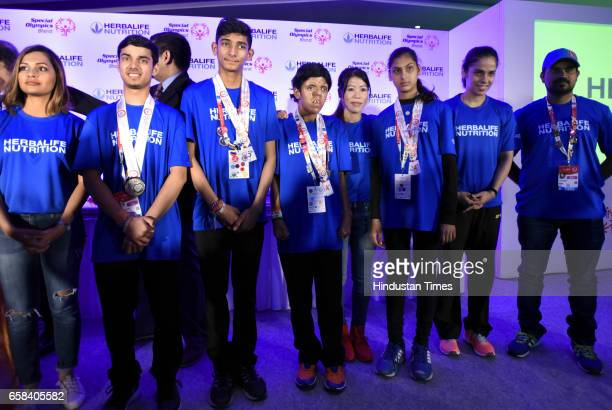 Indian special Olympics athletes win Gold Silver and bronze medals and meet with Rajya Sabha MP and Boxer Mary Kom Badminton Player Saina Nehwal Air...
