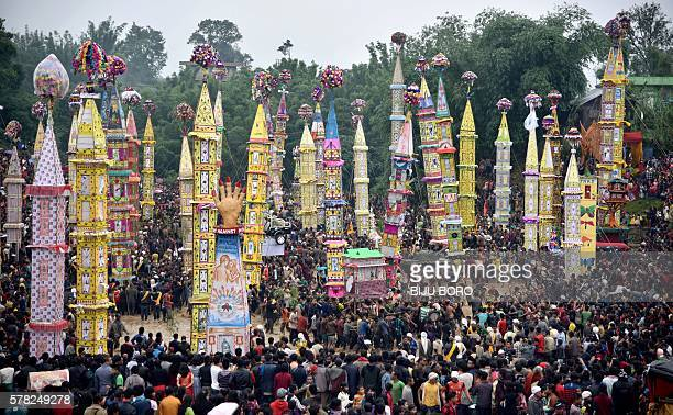 Indian spectators watch as Pnar or Jaintia tribesmen pull a Rong chariot and dance in muddy waters during the celebration of the Behdienkhlam...