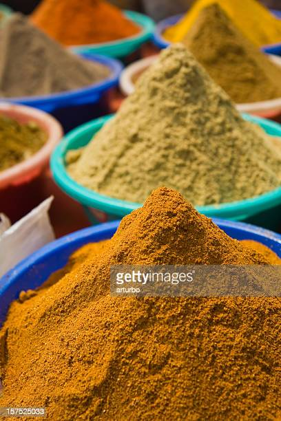 indian spices displayed in a shop - garam masala stock photos and pictures