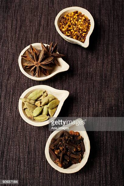Indian spices in clay pots.