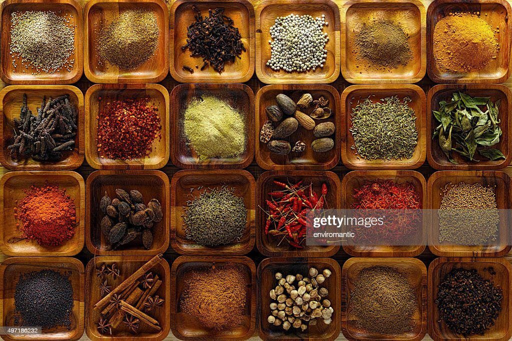 Indian spices in wooden trays. : Stock Photo