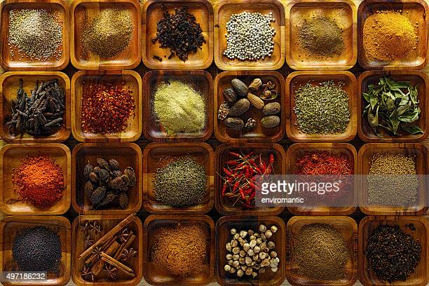 indian spices in wooden trays. - spice stock pictures, royalty-free photos & images