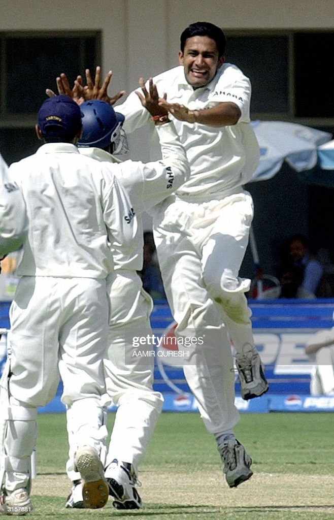 Indian spin bowler Anil Kumble (R), captain Rahul Dravid (C) and teammate Venkatsai Laxman (L) celebrate the dismissal of Pakistani batsman Inzamam-ul-Haq (not in picture) during the third days play of the first Test between Pakistan and India in Multan, 30 March 2004. Chasing India's first inning's score of 675 runs, Pakistan made 252 for the loss of four wickets at the tea break. AFP PHOTO/Aamir QURESHI