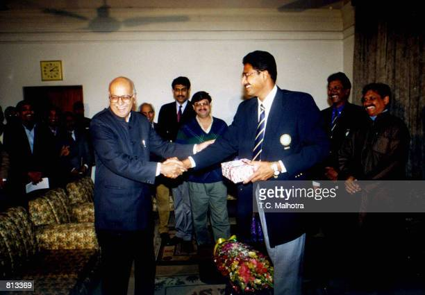 Indian spin bowler Anil Kumble , who took all the 10 Pakistani wickets in a cricket test match, mets with the Indian Home Minister, L.K. Adwani in...