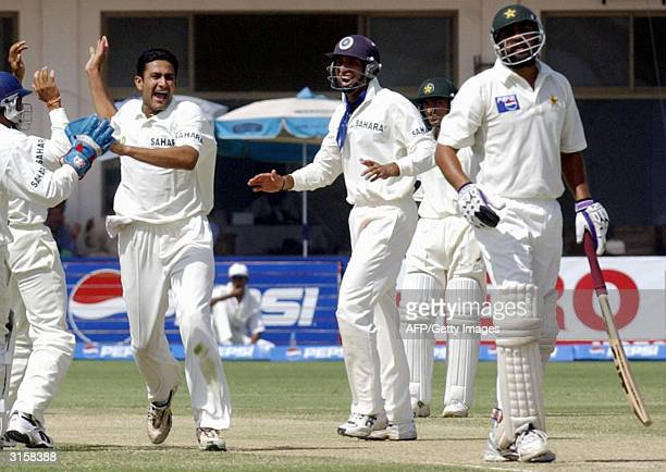 Indian spinner Anil Kumble celebrates a wicket of Pakistani captain Imzamamul Haq during the third day of the first Test match between Pakistan and...