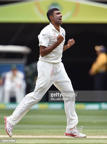 Indian spinner Ravi Ashwin celebrates after dismissing Australian batsman David Warner during the fourth day of the third cricket Test match against...