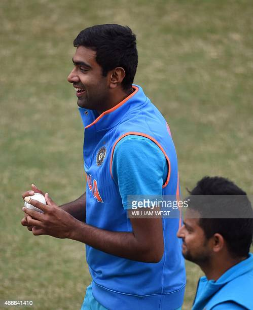 Indian spinner Ravi Ashwin prepares to bowl during a training session ahead of their 2015 Cricket World Cup quarterfinal match against Bangladesh in...