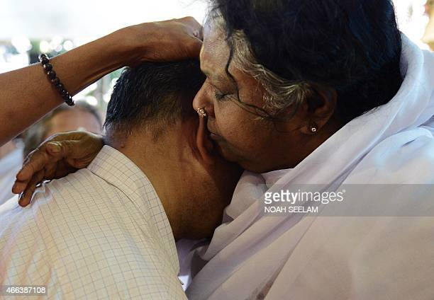 Indian spiritual figure Mata Amritanandamayi known by her followers as amma hugs a devotee during an event in Hyderabad on March 15 2015 Mata...