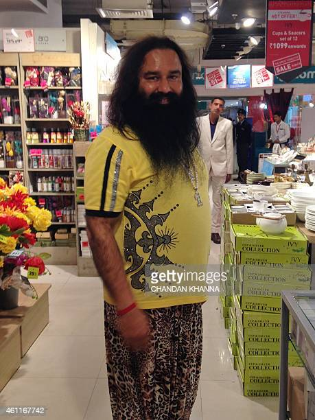 Indian spiritual guru Gurmeet Ram Rahim poses for a photograph after he was spotted at a shopping mall in New Delhi on January 5 2015 Indian police...