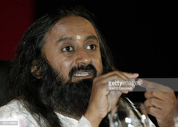 Indian Spiritual Guru Shri Shir Ravi Shankar gestures as he speaks during the second day of the India Today Conclave in New Delhi 26 February 2005...