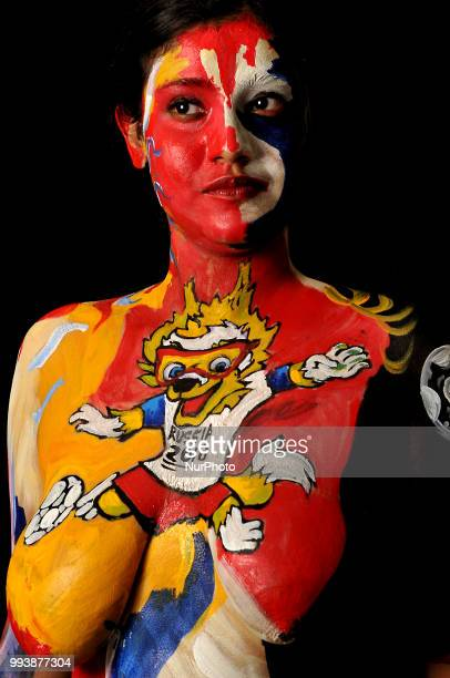 A Indian Sports Lover for FIFA World Cup Russia 2018 by having the official mascot painted on her with body paint on July 082018 in KolkataIndiaBody...