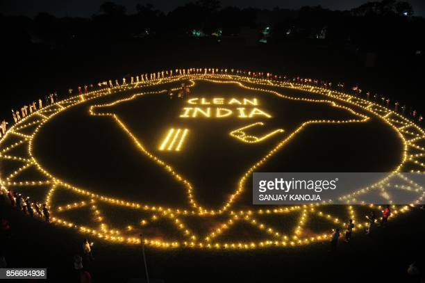 Indian sports people light candles and made a map of india at Madan Mohan Malviya stadium to mark Swachh Bharat Abhiyan cleanliness campaign on the...