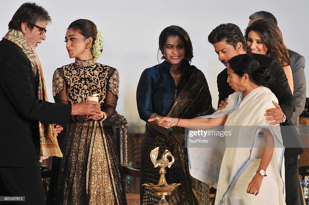 Indian Star Actor Amitabh Bachchan lighting a lamp along West Bengal Chief Minister Mamata Banerjee Actor Shah Rukh Khan Actor Sanjoy Dutta Veteran...