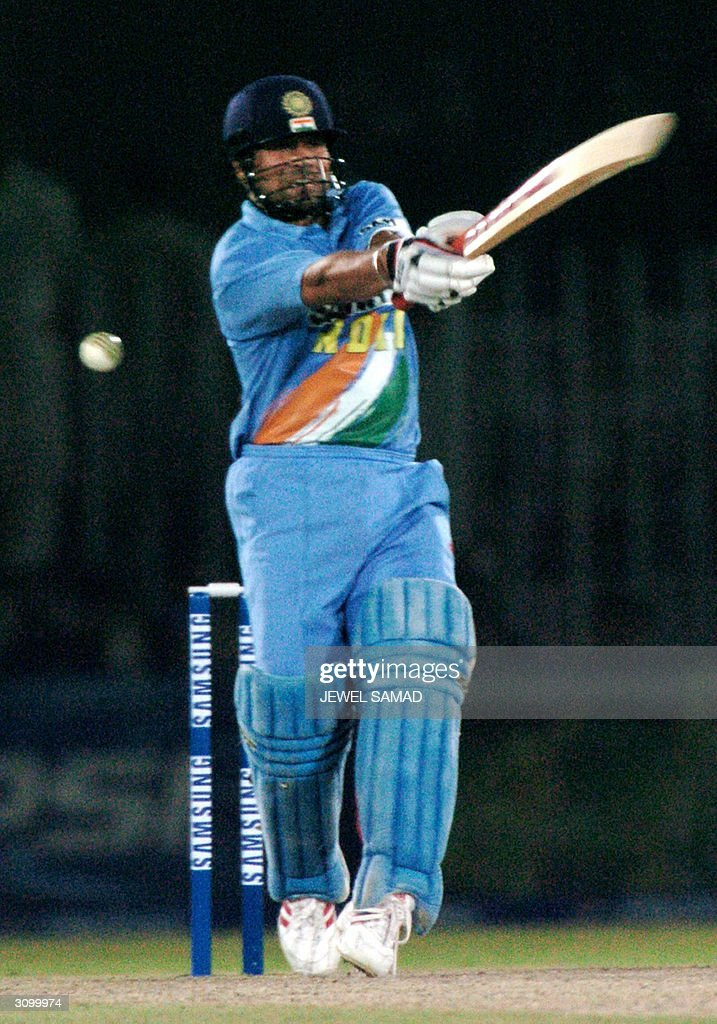 Indian star batsman Sachin Tendulkar hits a ball off Pakistani speed star Shoaib Akhtar (not in picture) on his way to complete his century during the second One Day International (ODI) match between India and Pakistan at the Pindi Cricket Ground in Rawalpindi, 16 March 2004. Tendulkar hit a century as India have lost three wicket for 180 runs at the end of 31overs as they are chasing Pakistan's 329 runs target. AFP PHOTO/Jewel SAMAD