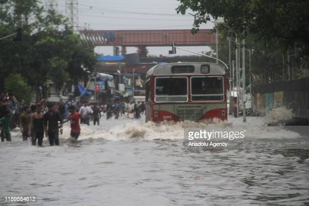 Indian State local transport bus moves through a flooded street following heavy monsoon rain in Mumbai, India on August 4, 2019. India's monsoon...