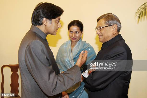 Indian State Minister of External Affairs Shashi Tharoor gestures as he chats with Indian foreign minister S M Krishna as Indian Minister of State...