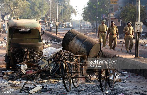 Indian state police patrol the streets of Ahmadabad, India after rioting between Muslims and Hindus March 1, 2002 in Ahmadabad, India, two days after...