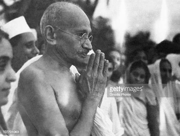 Indian statesman and activist Mohandas Karamchand Gandhi greeting people at Juhu Beach Mumbai May 1944