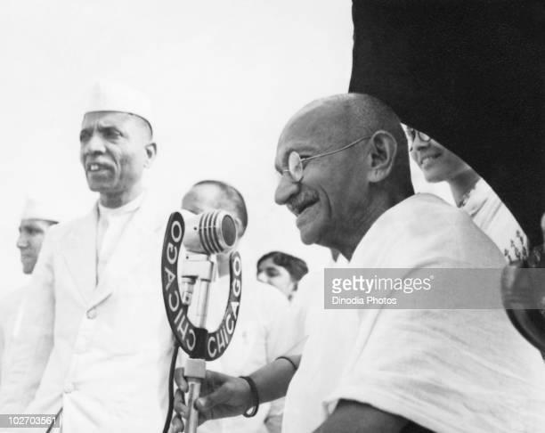 Indian statesman and activist Mohandas Karamchand Gandhi speaking into a microphone at Pune, 1944.