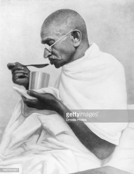 Indian statesman and activist Mohandas Karamchand Gandhi takes his last meal before his fast at Rashtriyashala Ashram Rajkot March 1939