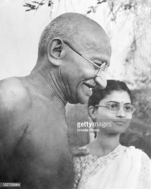 Indian statesman and activist Mohandas Karamchand Gandhi with Abha Gandhi at Pune 1944