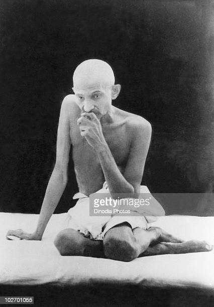 Indian statesman and activist Mohandas Karamchand Gandhi with shaved head in characteristic pose India circa 1940
