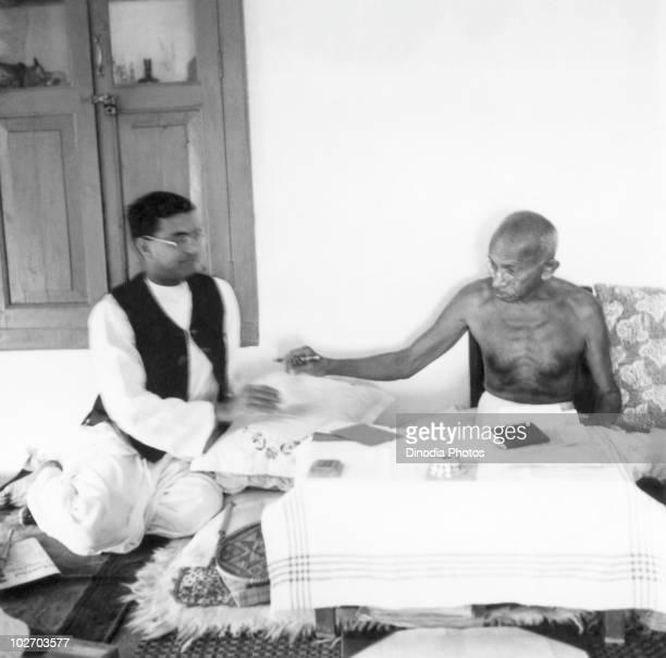 Indian statesman and activist Mohandas Karamchand Gandhi with Shriman Narayan at his residence Jeevan Kutir in Wardha India 1945