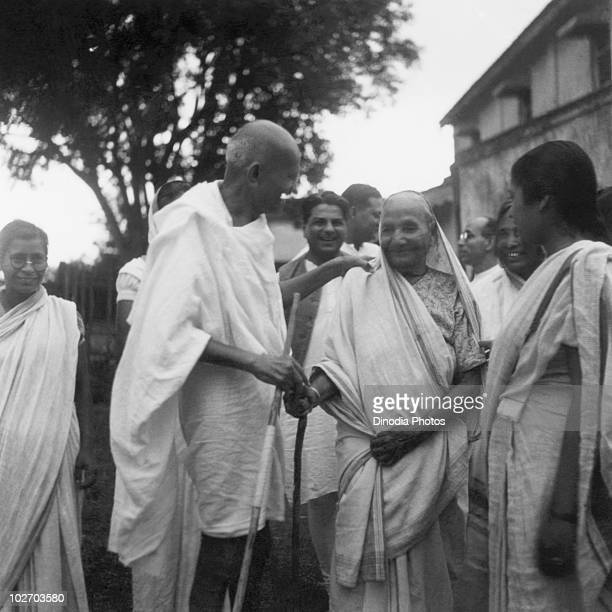 Indian statesman and activist Mohandas Karamchand Gandhi with the mother of his adopted son Jamnalal Bajaj in Wardha 1945 Also present are...
